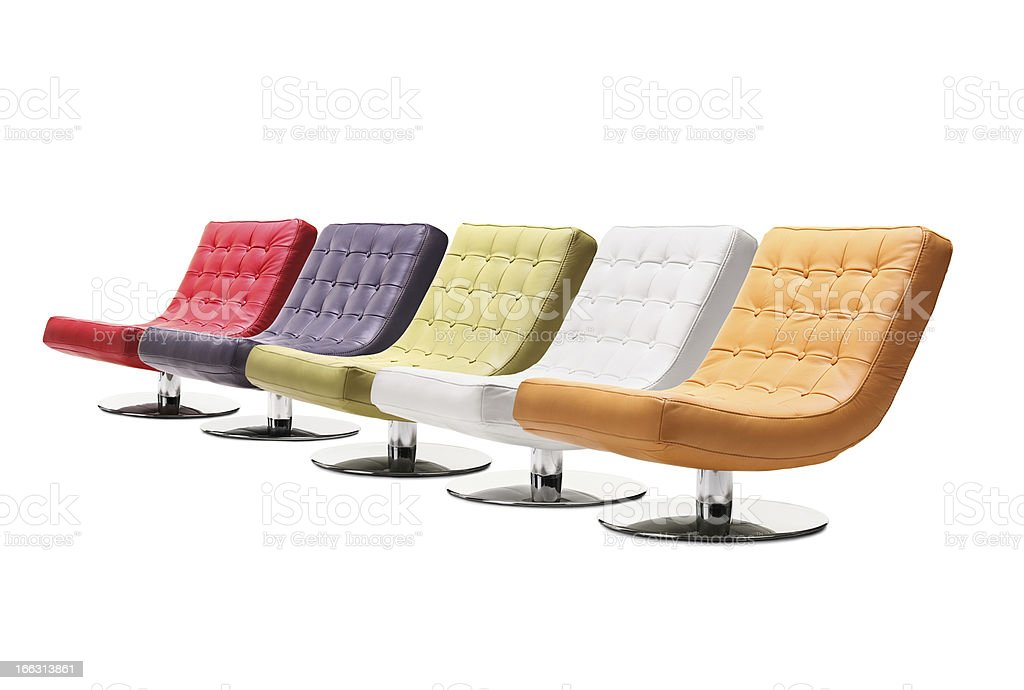 Studio shot of colorful leather armchairs royalty-free stock photo
