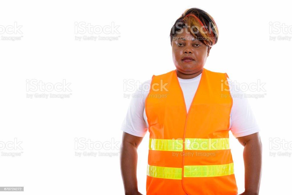 Studio shot of fat black African woman construction worker stock photo