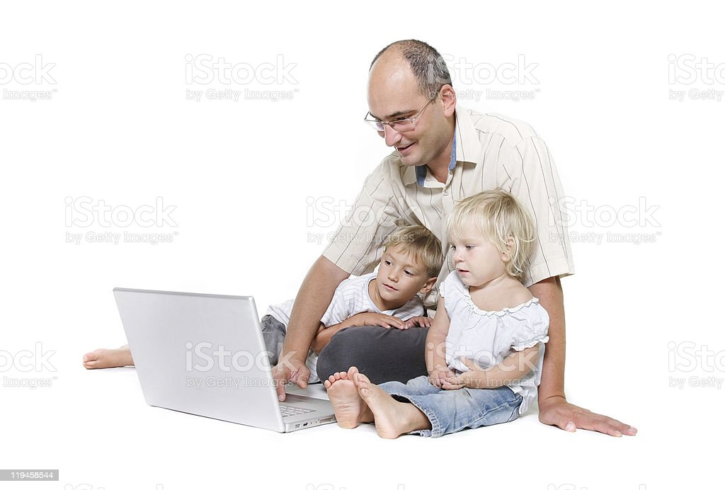 studio shot of father and two kids with laptop royalty-free stock photo