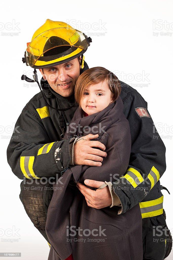 Studio shot of fireman holding little girl. stock photo
