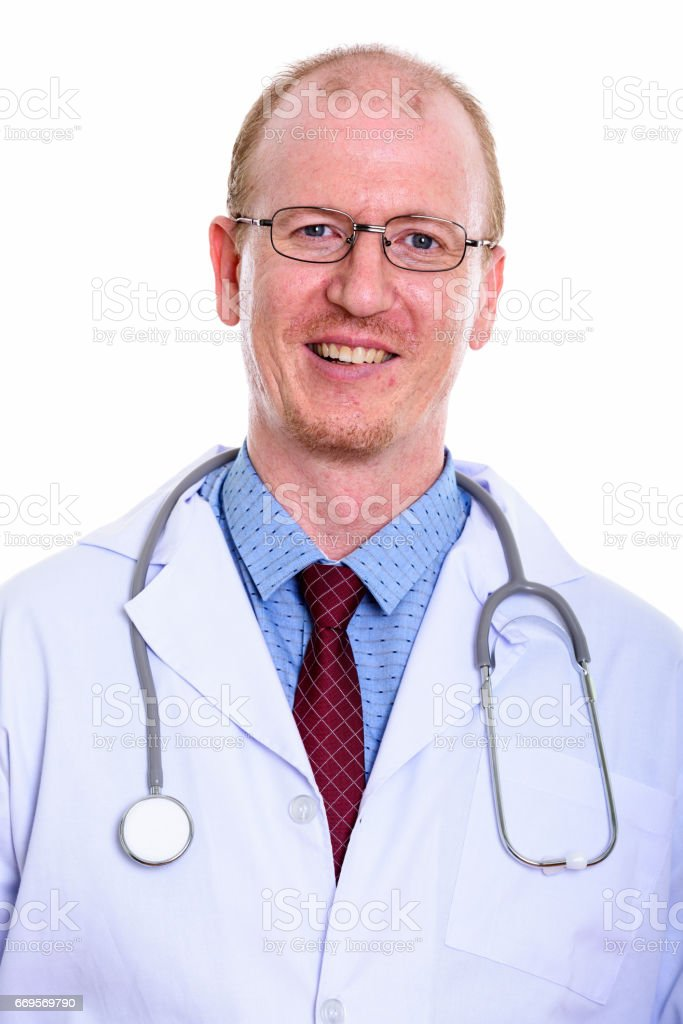 Studio shot of happy man doctor smiling stock photo