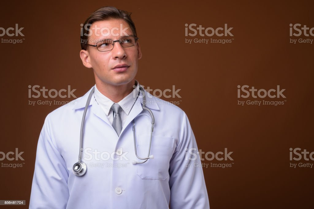 blonde man is punishing the hot doctor wearing glasses  77990