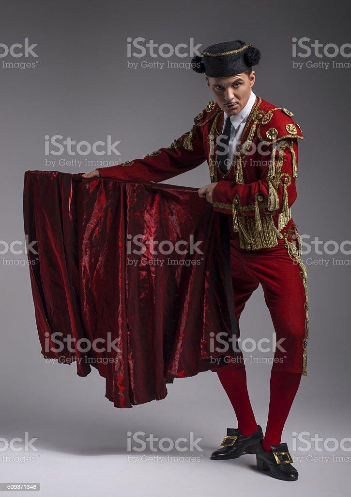 Studio shot of man dressed as Spanish matador stock photo