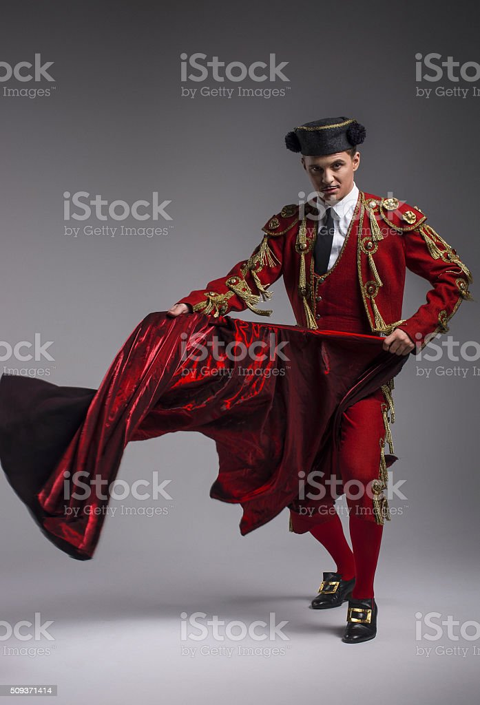 Studio shot of man dressed as Spanish matador stock photo