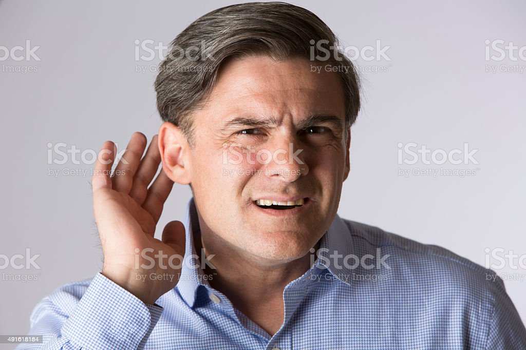 Studio Shot Of Man Suffering From Deafness stock photo