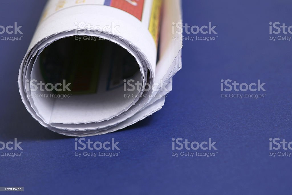Studio shot of Newspaper (blue background) royalty-free stock photo
