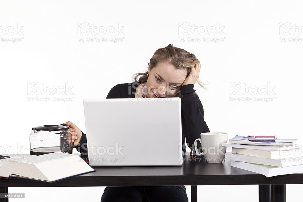 Studio shot of tired frustrated woman working on a computer royalty-free stock photo