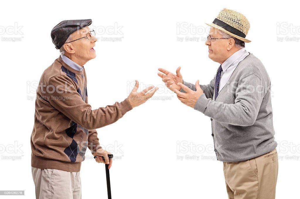 Studio shot of two senior gentlemen arguing stock photo