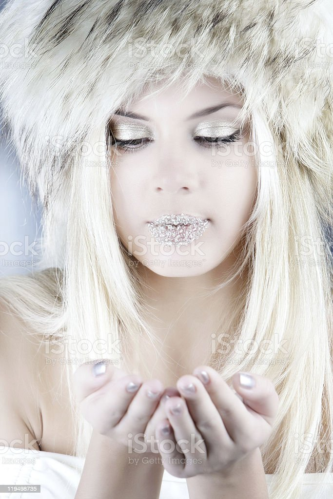 studio shot of winter girl with snowflakes in her hands royalty-free stock photo