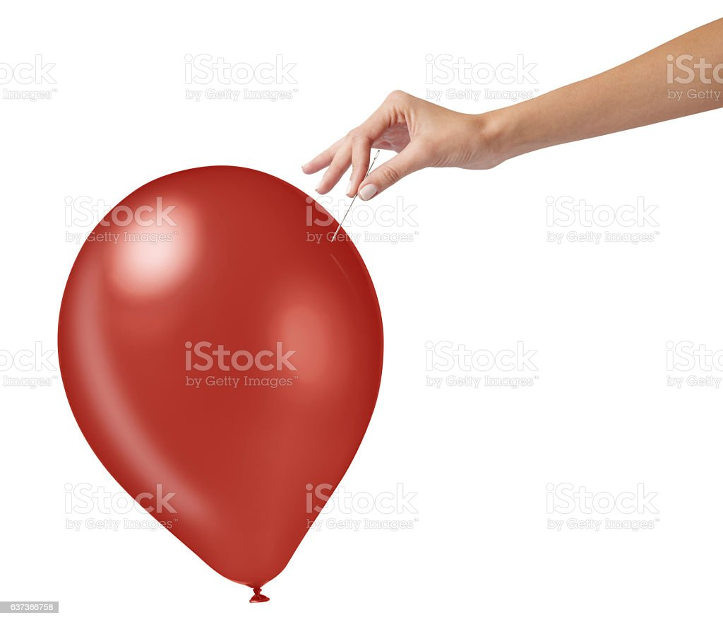 Studio shot of woman holding needle close to red balloon stock photo