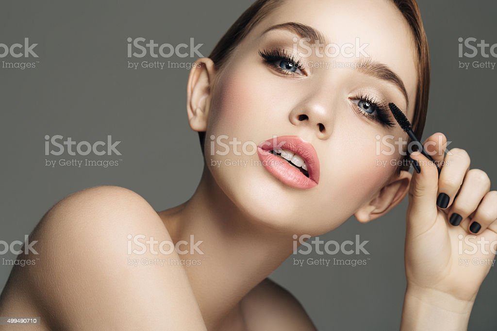 Studio shot of young beautiful girl stock photo