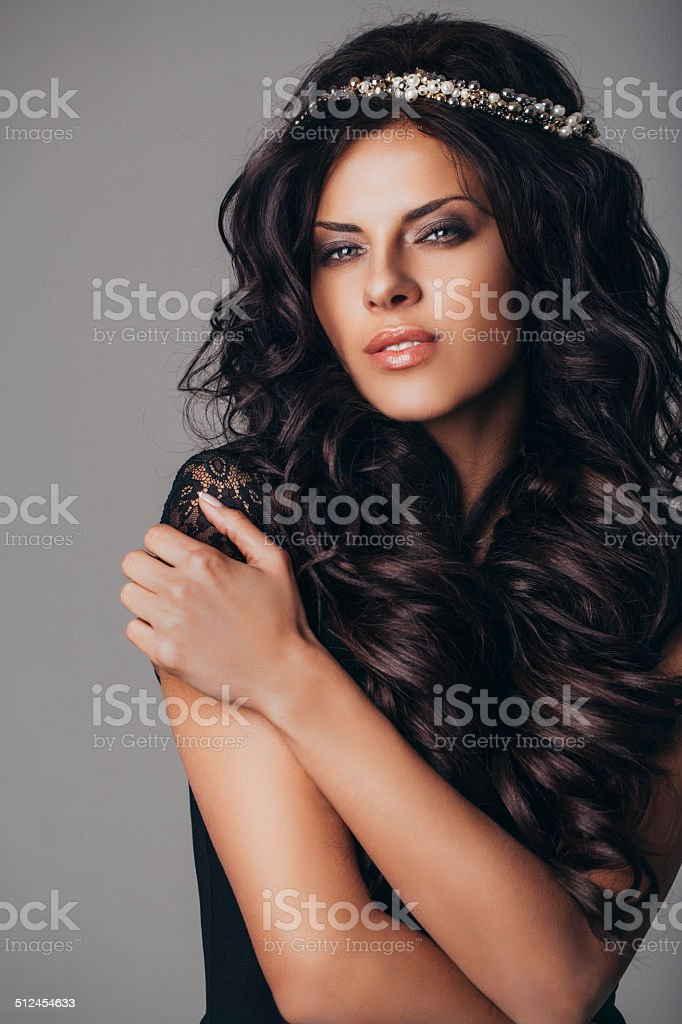 Studio shot of young beautiful woman on dark background stock photo
