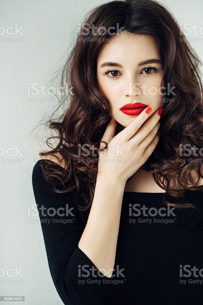 Studio shot of young beautiful woman on light background stock photo
