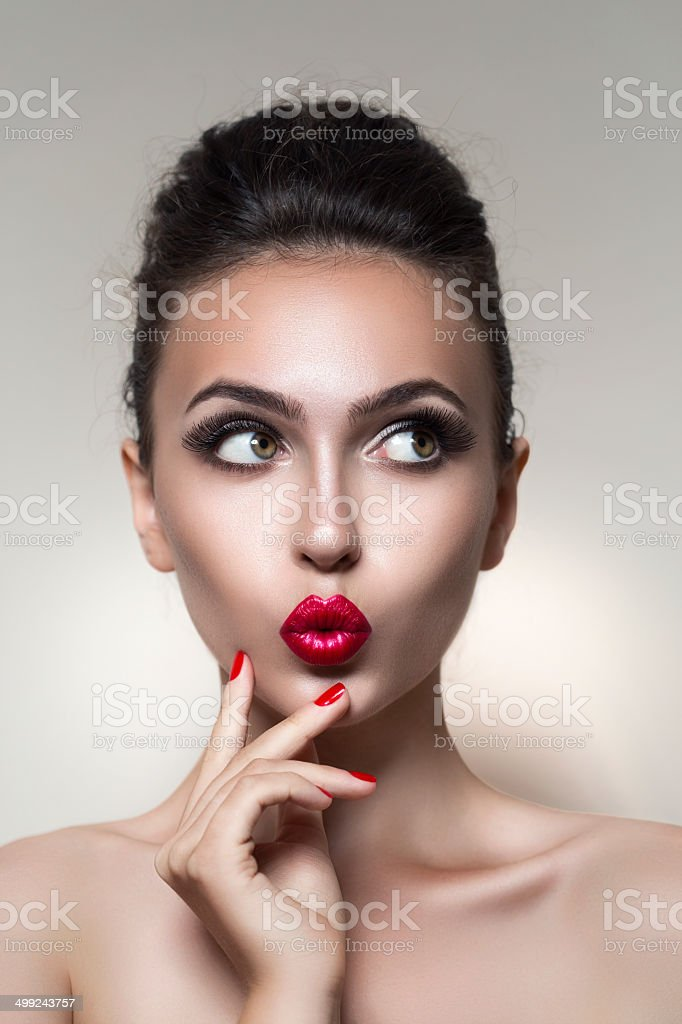 Studio shot of young beautiful woman stock photo