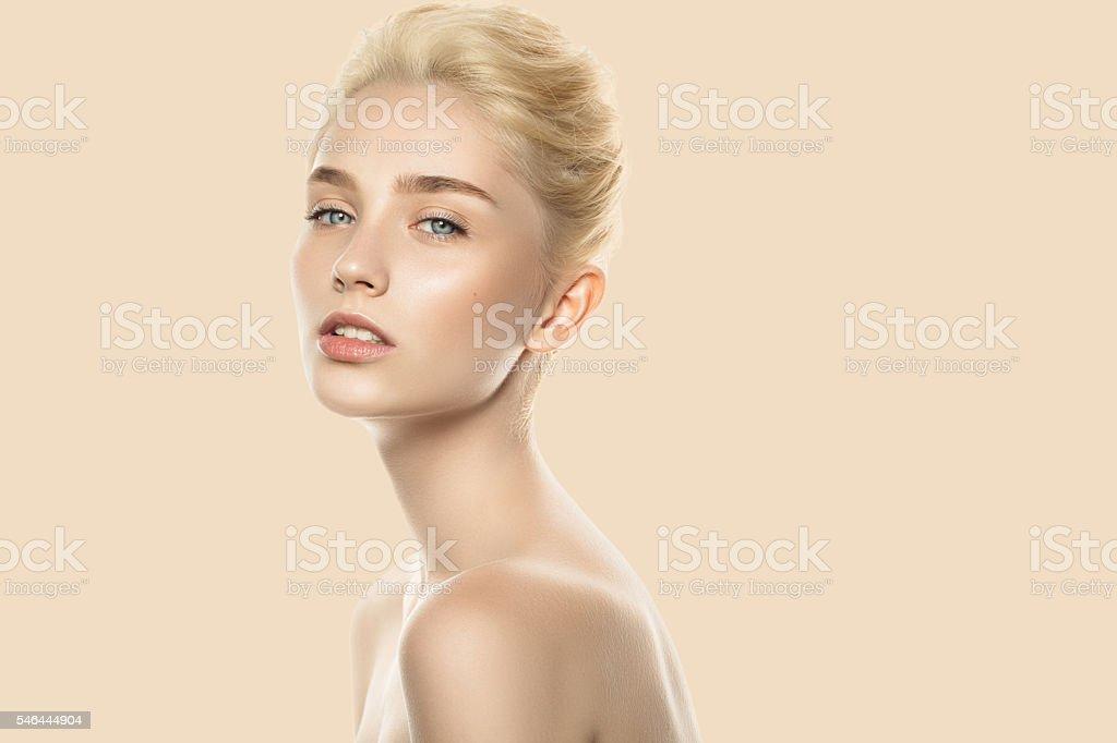 Studio shot of young beautiful woman. Professional make-up. stock photo