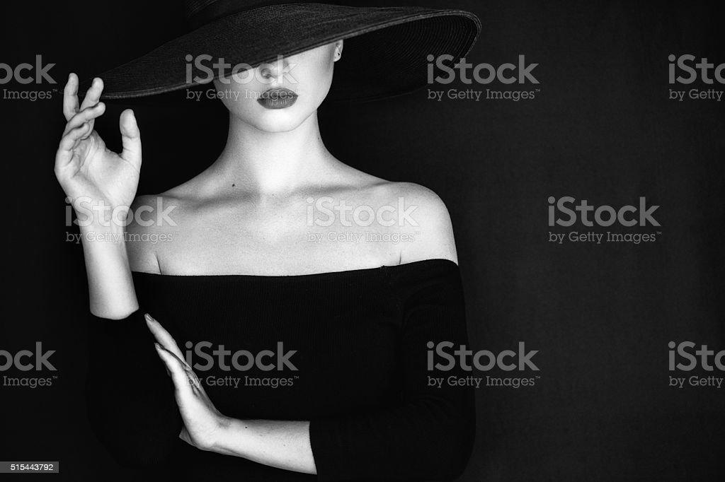 Studio shot of young beautiful woman wearing hat stock photo