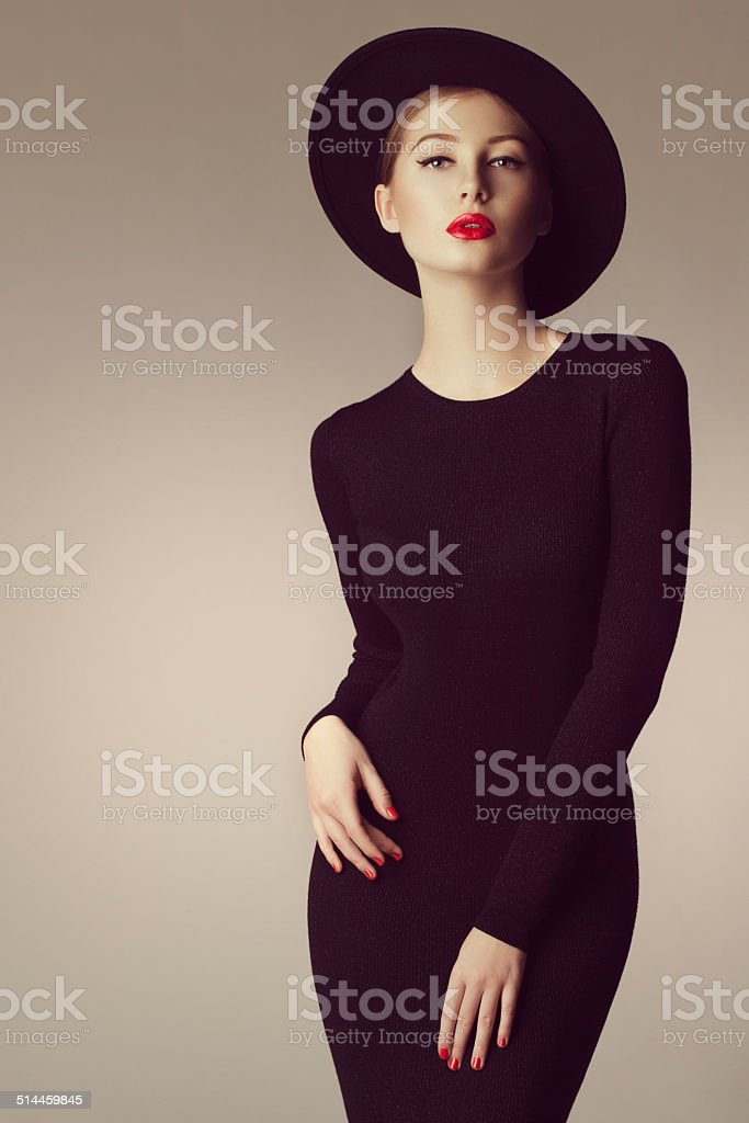 Studio shot of young beautiful woman wearing retro hat stock photo