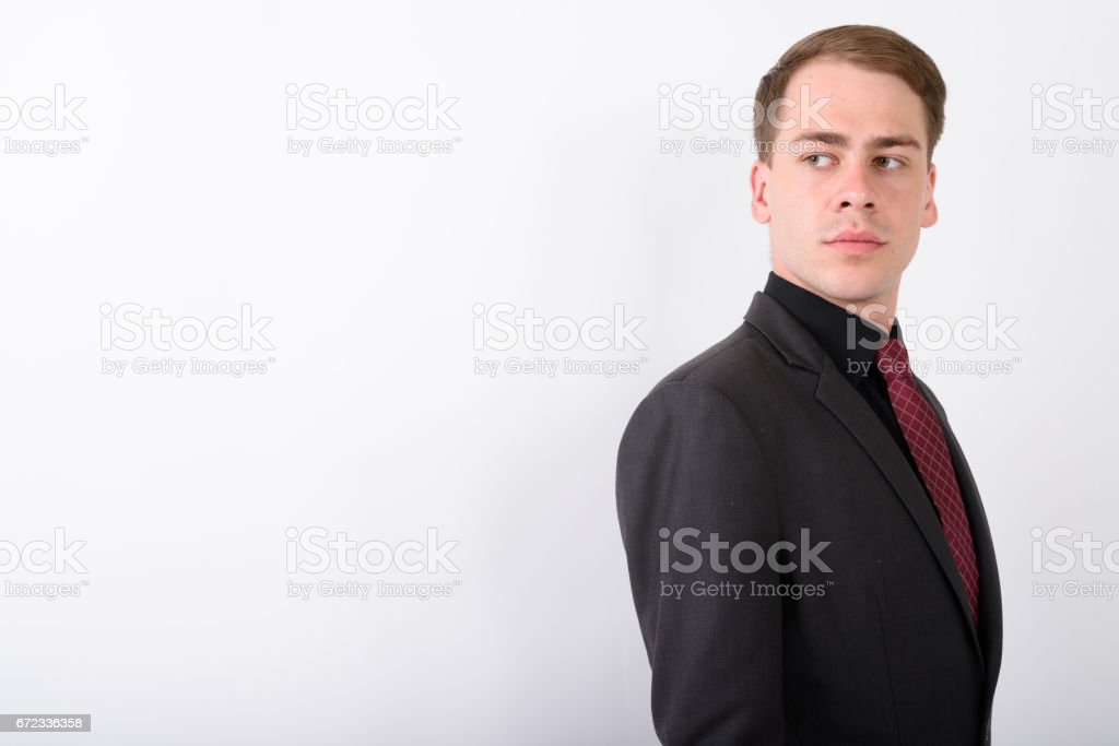 Studio shot of young businessman against white background stock photo