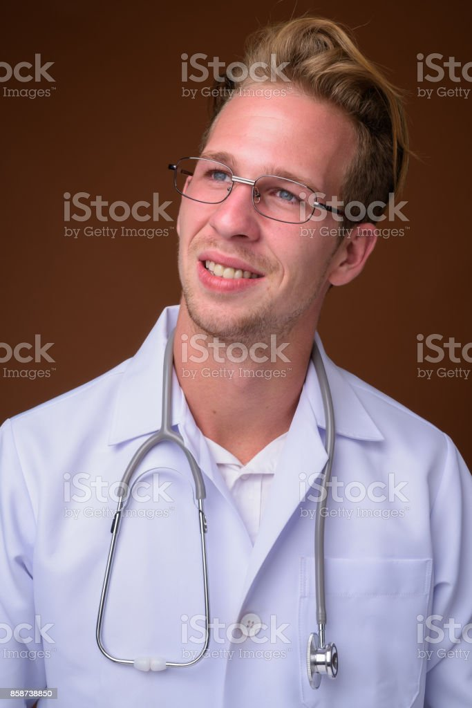 blonde man is punishing the hot doctor wearing glasses  78000