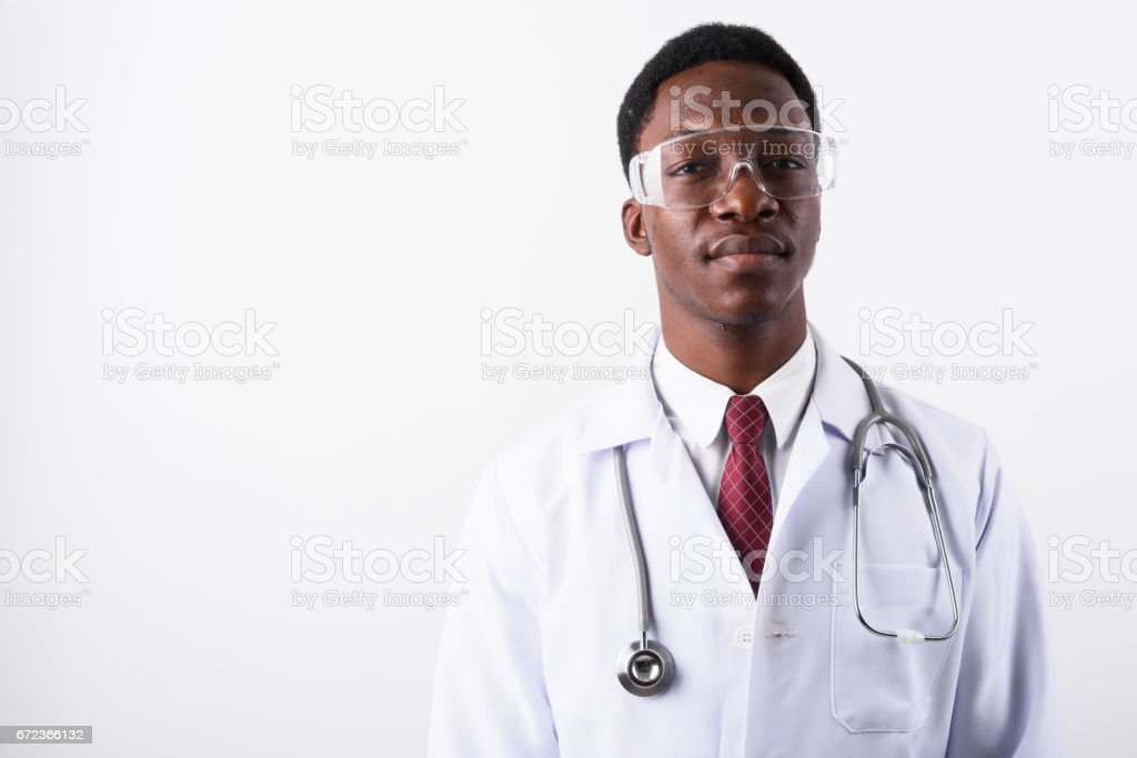 Studio shot of young muscular African man doctor against white background stock photo