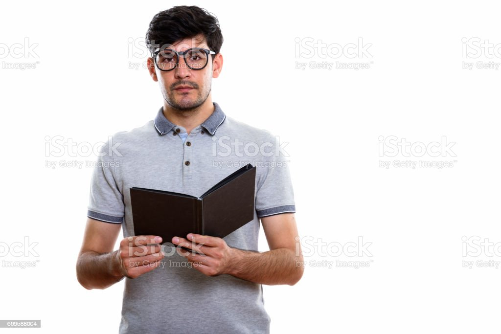Studio shot of young Persian man holding book stock photo