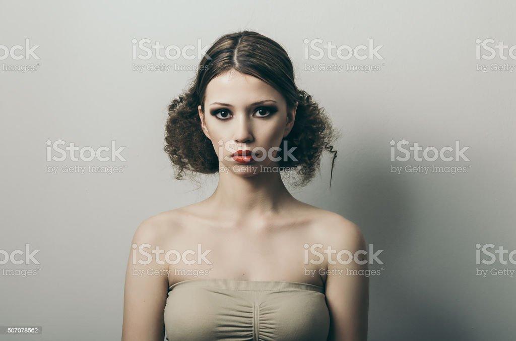 Studio shot of young woman model stock photo