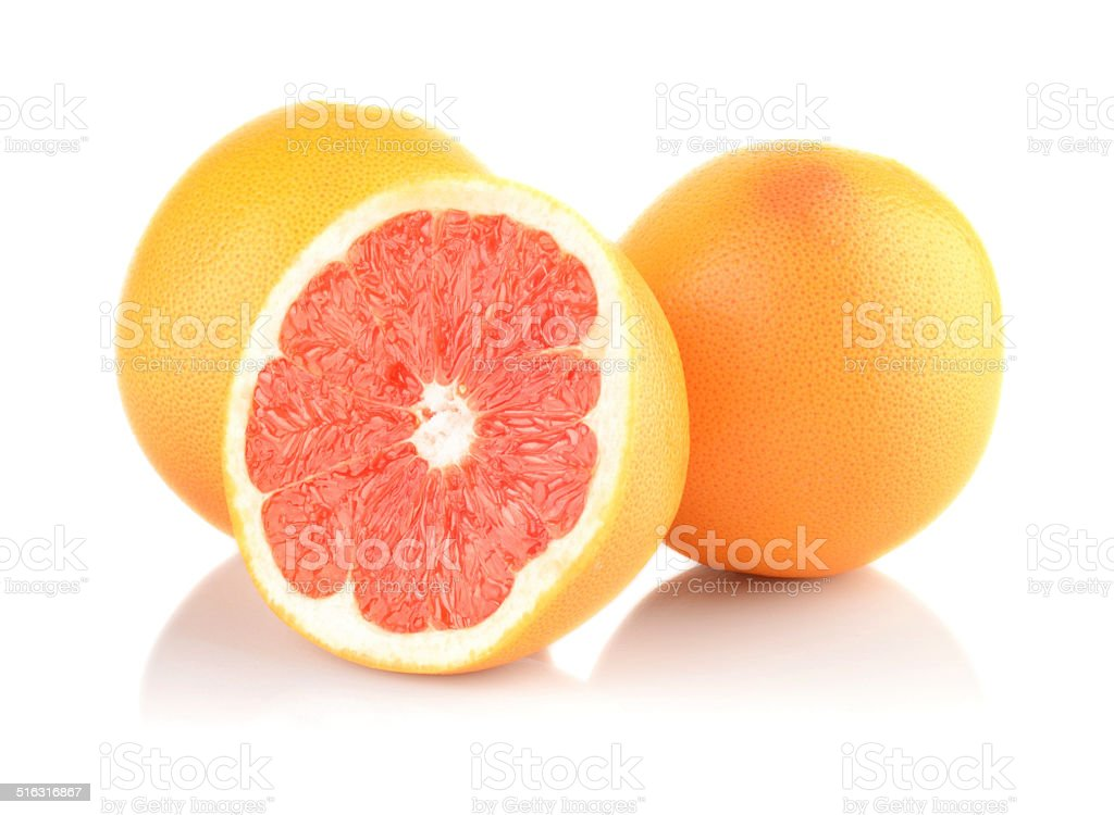 Studio shot sliced some grapefruits isolated white stock photo