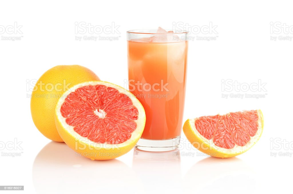 Studio shot sliced three grapefruits with juice isolated white stock photo