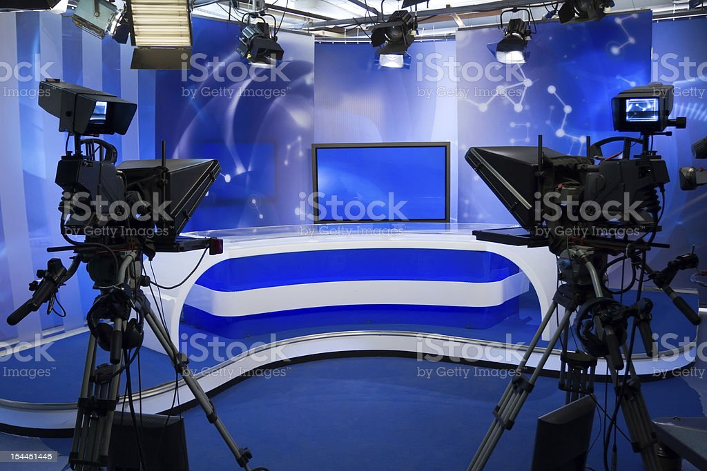 TV studio with camera and lights stock photo