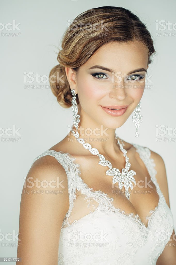Studioshot of young beautiful bride on light background stock photo