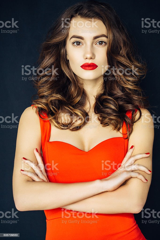 Studioshot of young beautiful woman on dark background stock photo