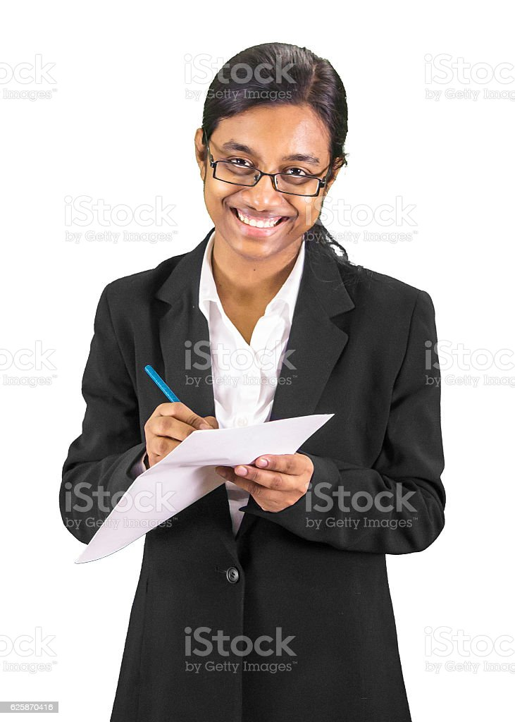 Studious professional woman taking notes. stock photo