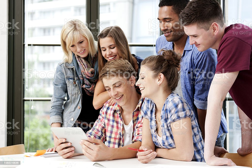 Study group with a digital tablet royalty-free stock photo
