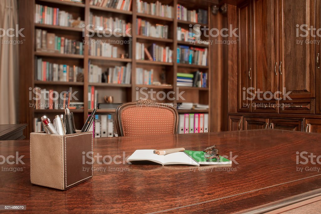 Study table with pens and books stock photo
