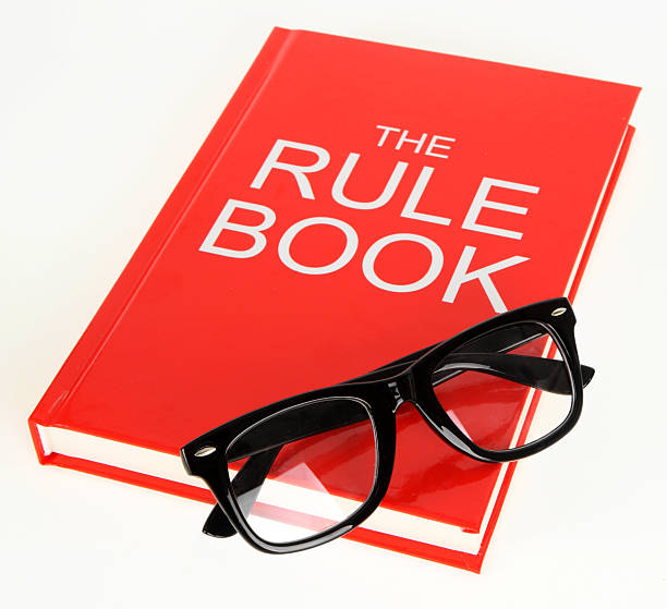 Rule Book Pictures Images And Stock Photos Istock