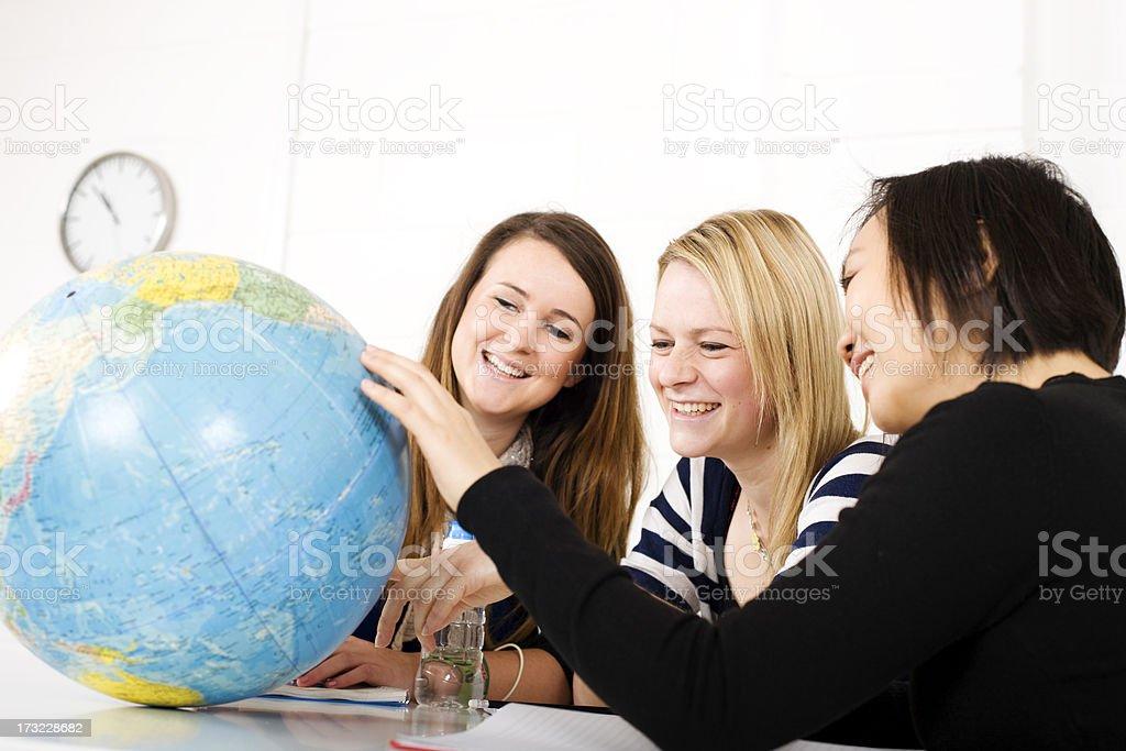 Studying a globe royalty-free stock photo
