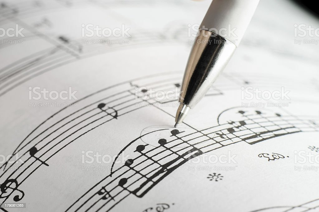 Studying a musical sheet. royalty-free stock photo