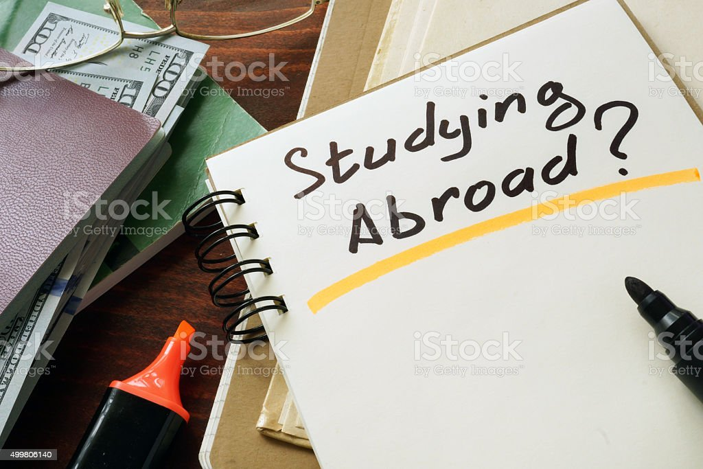 Studying Abroad  concept. Notepad on the table. stock photo