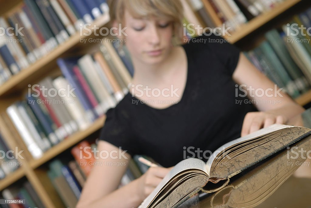 Studying at library royalty-free stock photo