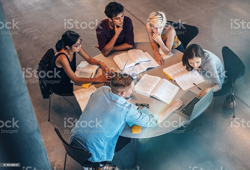 Studying group of students at the table stock photo