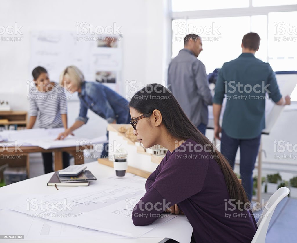 Studying the blueprints thoroughly to eradicate any errors royalty-free stock photo