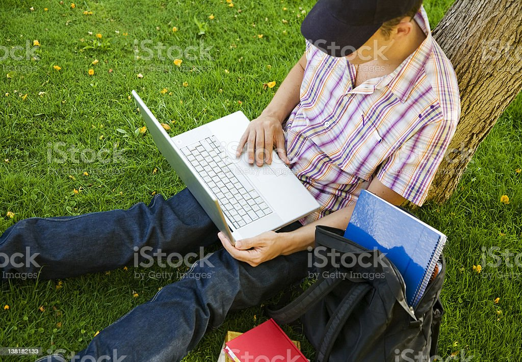 Studying with laptop on park royalty-free stock photo