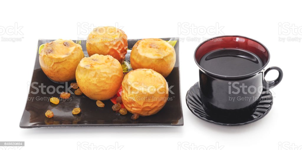 Stuffed apples and a cup of tea. stock photo