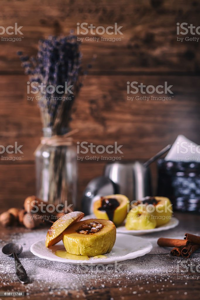 stuffed baked apple with nuts, honey and chocolate stock photo