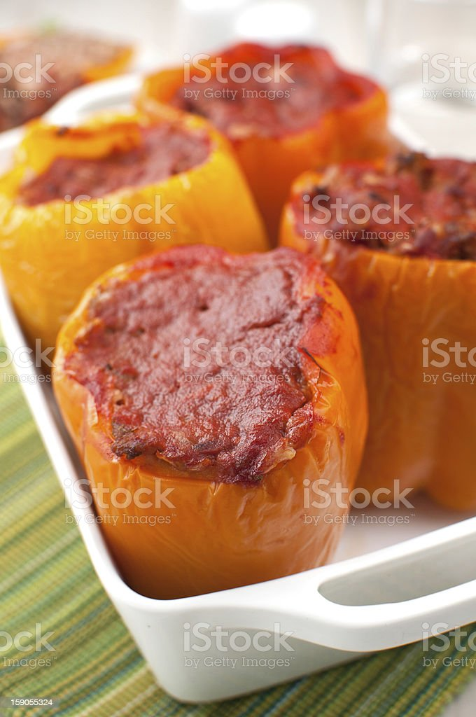 Stuffed baked bell pepper with tomato sauce stock photo