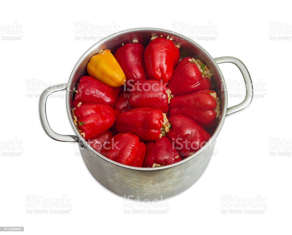 Stuffed bell peppers in stainless steel saucepot on light backgr stock photo