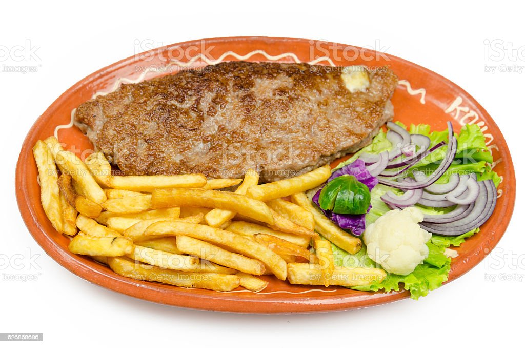 stuffed burger with salad and fries decorated stock photo