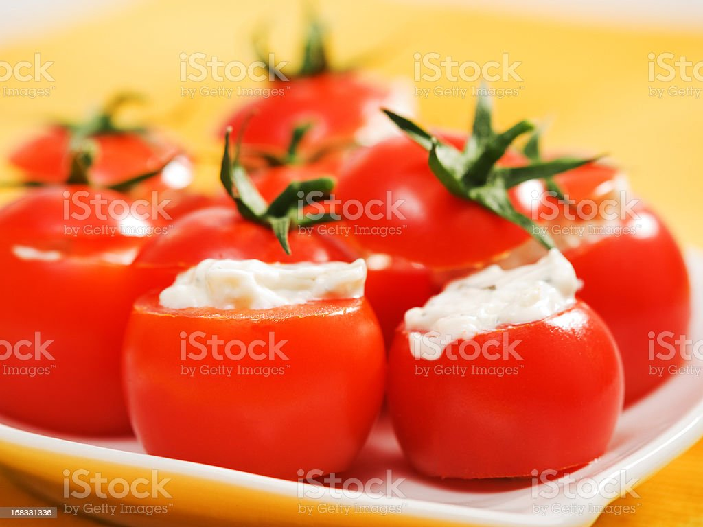 Stuffed cherry tomatoes with cheese cream royalty-free stock photo