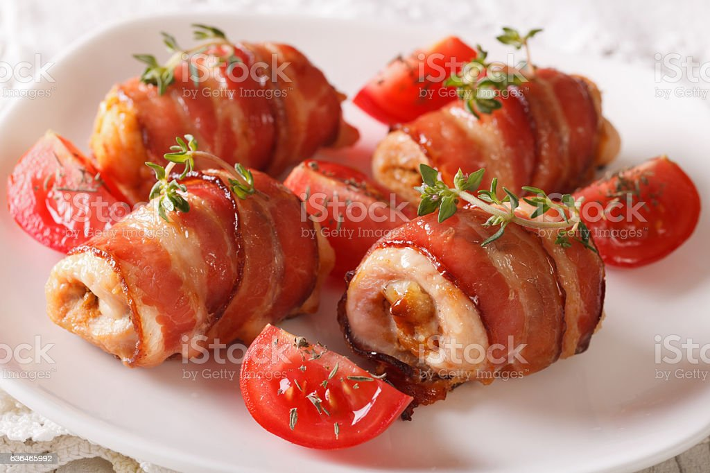 Stuffed chicken breast wrapped in bacon close-up. horizontal stock photo