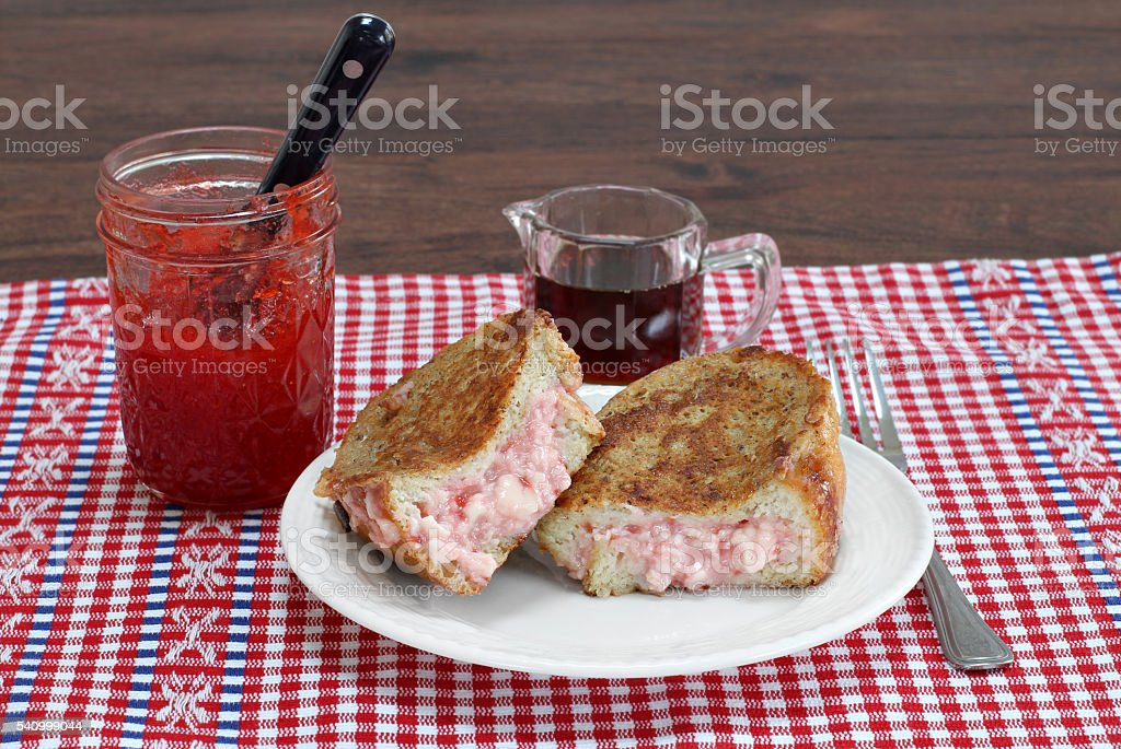 Stuffed french toast with strawberry jam and cream cheese. stock photo